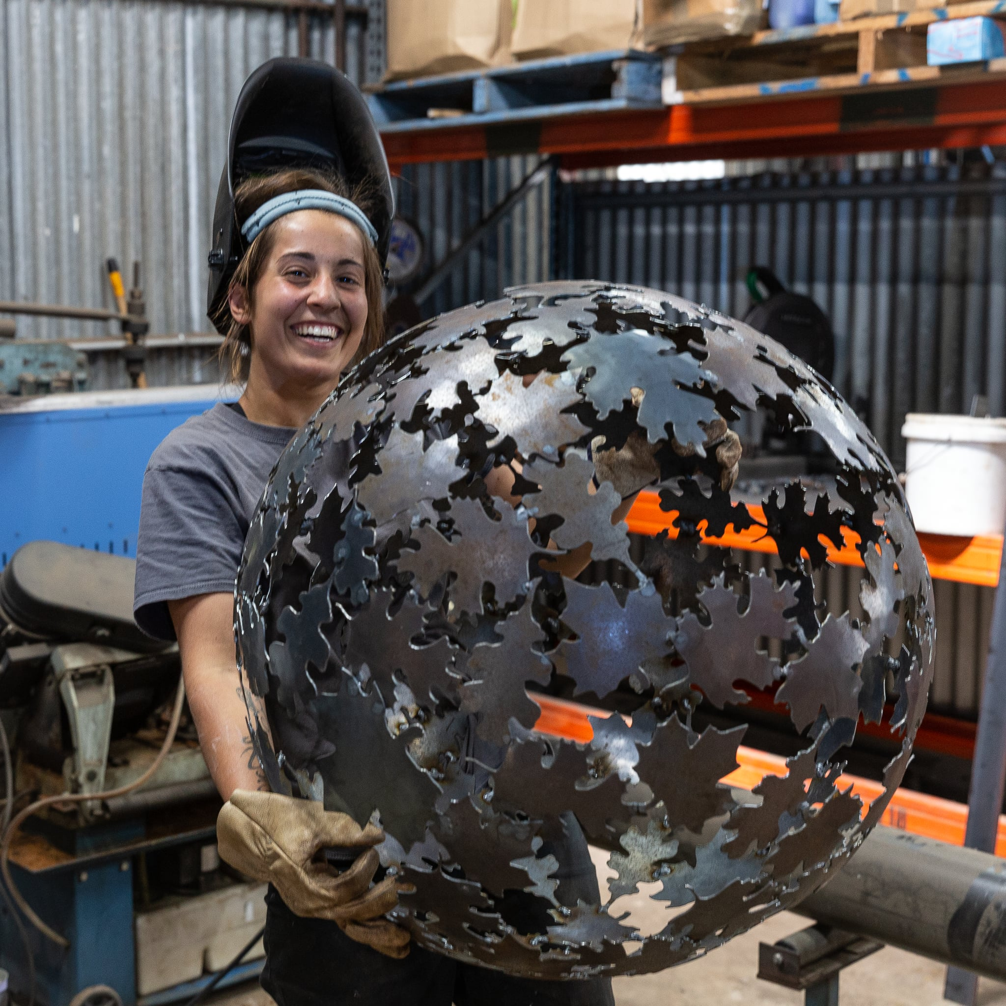 Woman holding spherical sculpture